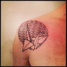 Schemes and bird origami tattoo on shoulder