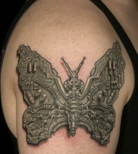 Schemes and butterfly tattoo on shoulder