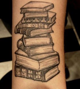 Science source book tattoo on arm