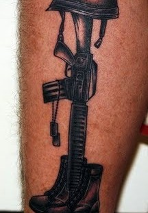 Shoes, helmet and gun soldier tattoo on arm