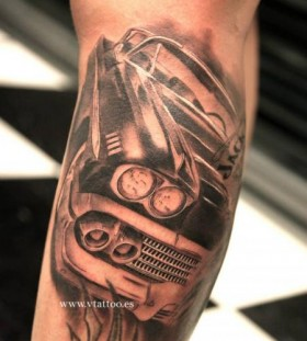 Simple black car tattoo on arm