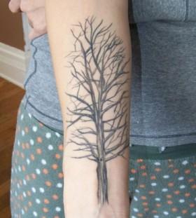 Simple black tree tattoo on arm