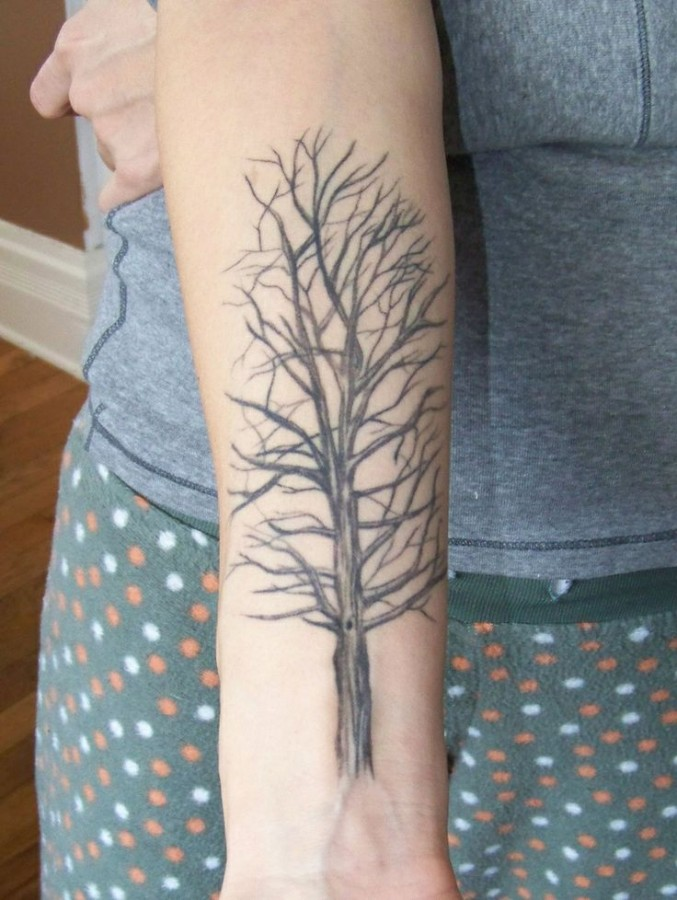 Simple black tree tattoo on arm