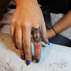 Simple black wolf tattoo on arm