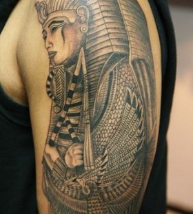 Simple egypt style face tattoo on arm