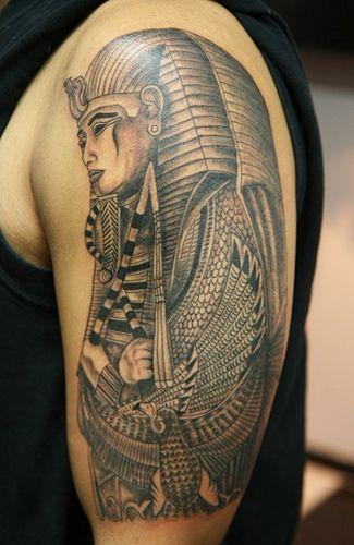Simple egypt style face tattoo on arm
