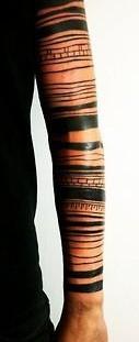 Simple men's line tattoo on arm