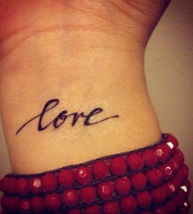 Simple pretty love tattoo on arm