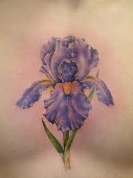 Simple purple flower tattoo on chest