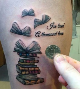 Simple quotes and book tattoo on arm