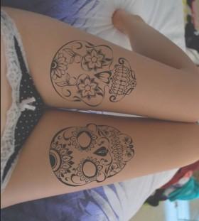 Simple skull tattoo on leg