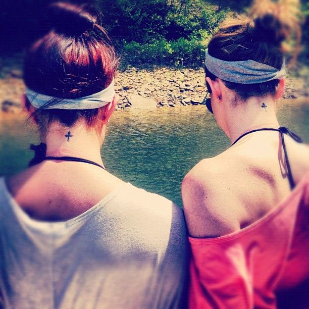 Sisters black back cross tattoo
