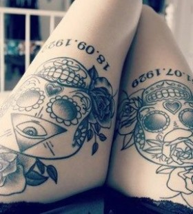 Skull and black flower tattoo on leg