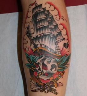 Skull and lovely ship tattoo on leg