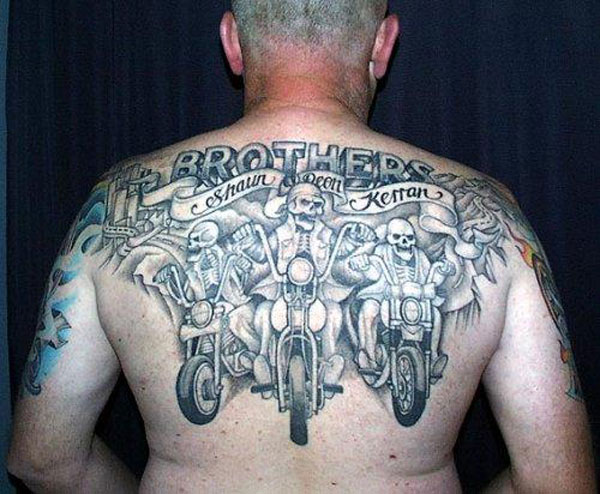 Skull brothers bicycle tattoo on back