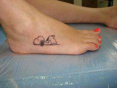 Sleeping snoopy tattoo