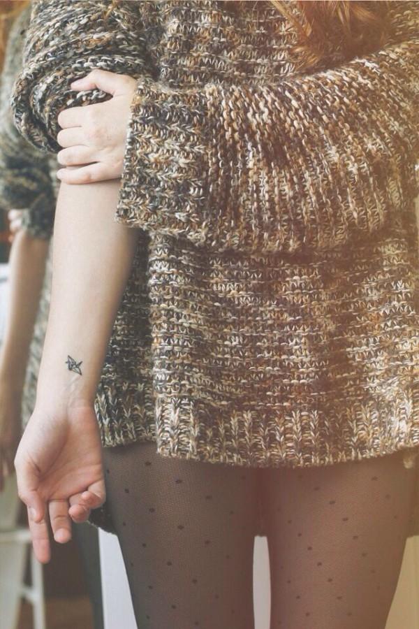 Small bird origami tattoo on arm