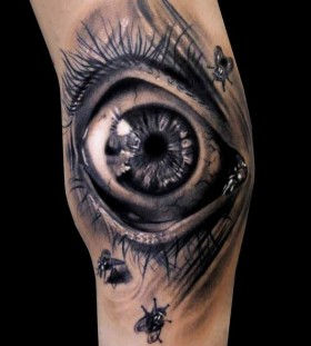 Small insect and scary eye tattoo on arm
