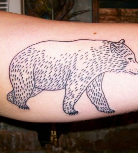 Small lovely bear tattoo on arm