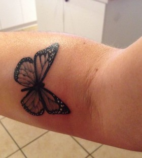 Small lovely butterfly tattoo on arm