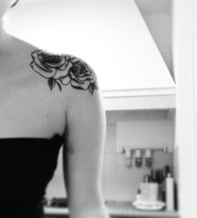 Small pretty black and white color rose tattoo on shoulder
