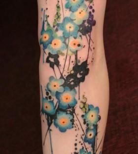 Small pretty blue flowers tattoos