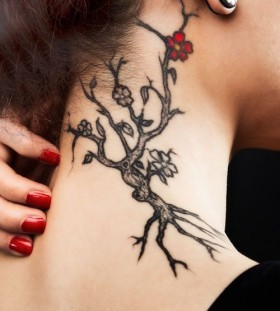 Small red flower and tree tattoo on shoulder