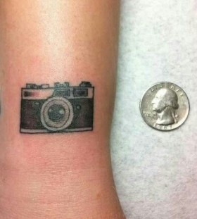 Small simple camera tattoo on arm