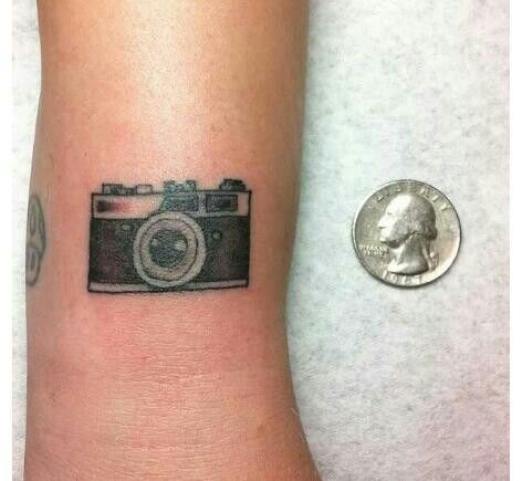 Cameras tattoos on arms