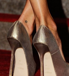 Small star tattoo with shoes