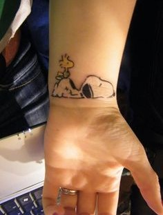 Snoopy tattoo on wrist