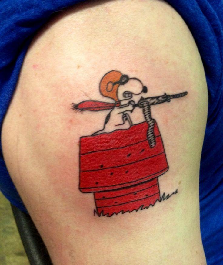 Snoopy with gun tattoo