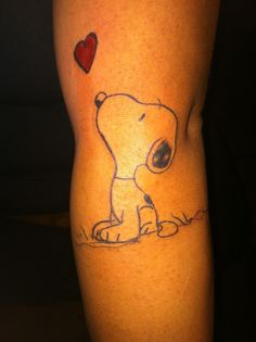 Snoopy with heart tattoo