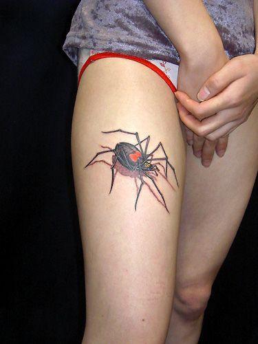 Spider tattoo on leg