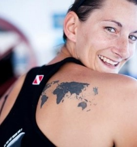 Sports womens and map tattoo on back