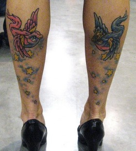 Stars and colorful birds tattoos on legs