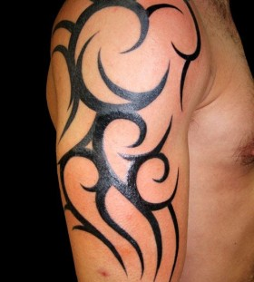 Strong men's tribal tattoo on arm