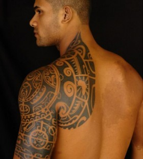 Strong men's tribal tattoo on shoulder