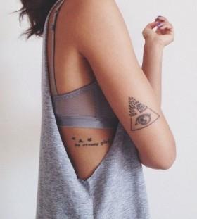 Triangle with eye tattoo