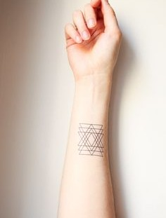 Triangles tattoo on arm