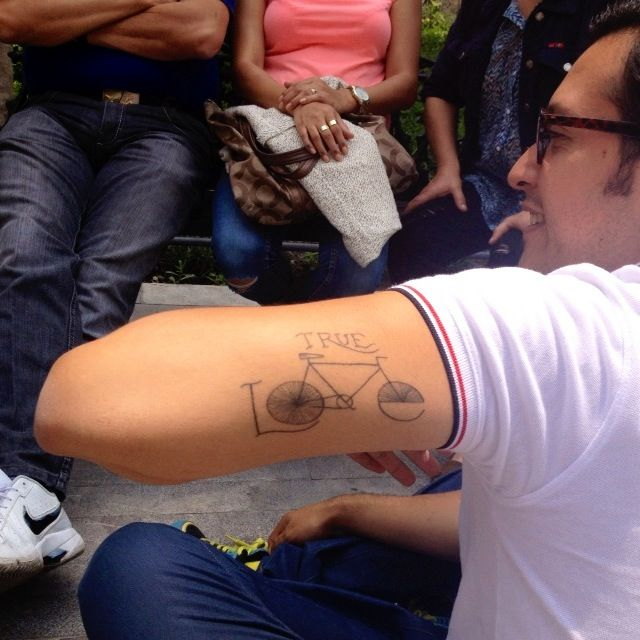 True love bicycle tattoo on arm