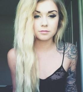 Unique blonde girl rose tattoo on shoulder