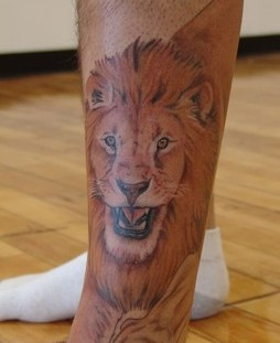 Unique pretty lion tattoo on leg