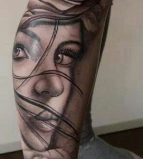 Unique women face tattoo on leg