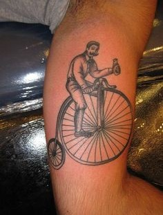 Vintage bicycle tattoo on leg