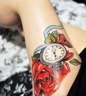 Watch and red rose tattoo on leg