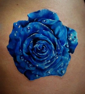 Water droplets and blue flowers tattoos