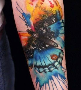 Watercolor awesome butterfly tattoo on arm