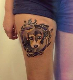 Watercolor sad dog tattoo on leg