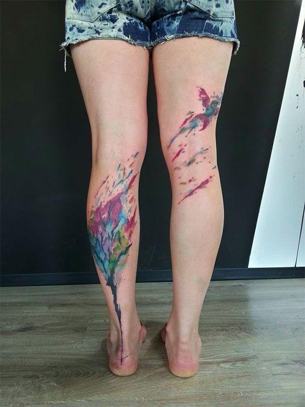 Watercolor tree and bird tattoo on leg